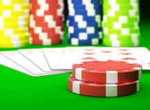 Gambling chips. And poker cards on green carpet - 3D render Stock Photos