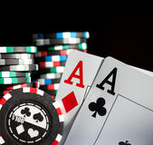 Gambling chips and aces royalty free stock photos