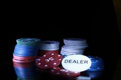 Gambling chips on the black. Background stock images