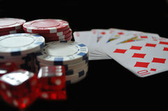 Gambling. Chips, cards and dice on black royalty free stock images