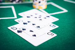 Gambling chips and cards on a green cloth Stock Photo