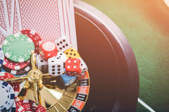 Gambling chips and cards on a green cloth Casino Royalty Free Stock Photos