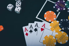 Gambling chips and cards on a green cloth Casino Stock Photography