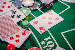 Gambling chips and cards on a green cloth Casino Royalty Free Stock Photography