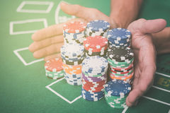 Gambling chips and cards on a green cloth Casino Royalty Free Stock Photo