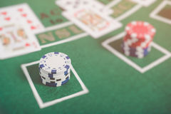 Gambling chips and cards on a green cloth Casino Stock Images