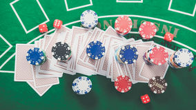 Gambling chips and cards on a green cloth Casino Stock Photo