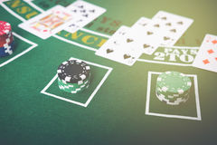 Gambling chips and cards on a green cloth Casino Stock Photos
