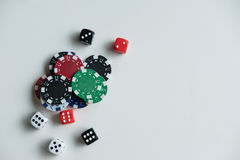 Gambling chips and cards on a green cloth Stock Image