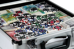 Gambling chips and cash. A briefcase full of cash and gambling chips Stock Image