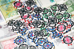 Gambling chips and cash. Currency Stock Photography