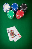 Gambling chips on casino felt and winning hand in royalty free stock photo