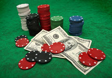 Gambling chips and dollar bills royalty free stock photo