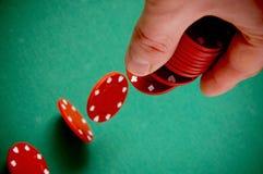 Gambling chips falling Royalty Free Stock Photos