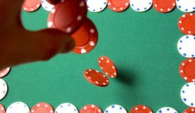 Gambling chips falling Royalty Free Stock Images