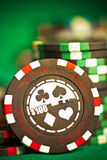 Gambling chips on green cloth Royalty Free Stock Photo