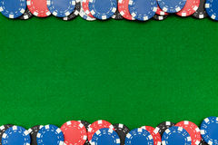 Gambling chips on green felt Royalty Free Stock Image