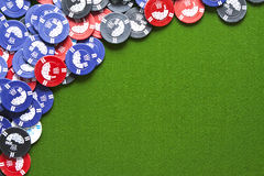 Gambling chips on green felt Stock Photography
