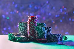 Gambling chips on green table stock photo