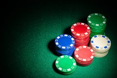 Gambling chips highlighted on casino table. Gambling chips highlighted on a casino table royalty free stock photography