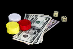 Gambling Chips Money and Dice on Black Background Royalty Free Stock Image