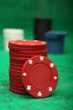 Gambling chips over green felt, Royalty Free Stock Image