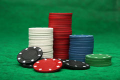 Gambling chips over green felt Royalty Free Stock Photo