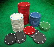 Gambling chips over green felt Stock Photos