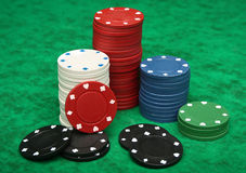 Gambling chips over green felt Royalty Free Stock Image