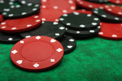 Gambling chips over green felt, Royalty Free Stock Photography