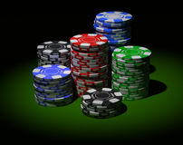 Gambling chips in piles Royalty Free Stock Photography