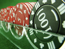 Gambling Chips Racked. Set of 100's & 5's gambling chips in rack Royalty Free Stock Images