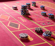 Gambling chips on red roulette table. Close up of gambling chips on red roulette table stock photos