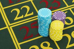 Gambling Chips on Roulette Table close up Stock Image