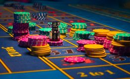 Gambling chips on table stock photos