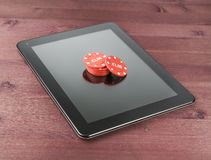 Gambling chips on tablet pc,texas game online Royalty Free Stock Photos