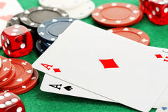 Gambling. Closeup of two aces with chips and dice, gambling concept stock photos