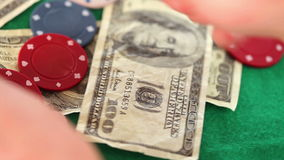Gambling coins and dollar bills spinning. On a gambling table stock footage