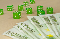 Gambling composition - a lot of money and dices Royalty Free Stock Photography