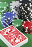 Gambling concept. Stacks of casino gambling chips with a deck of cards royalty free stock image