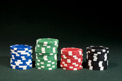 Gambling concept - chips in four color Stock Photos