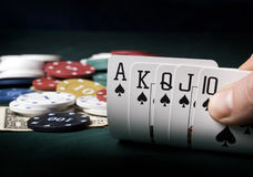 Gambling. Concept man holding a poker cards royalty free stock photo