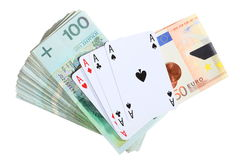 Gambling concept. Playing cards aces and money Stock Images