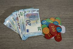 Gambling concept, saving money or hazard with euro banknote and. Chips composition royalty free stock image