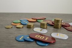 Gambling concept, saving money or hazard with euro coins and chi. Ps composition stock photos
