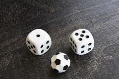 Gambling with dice and football win money Stock Image