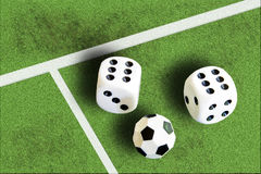 Gambling with dice and football win money Royalty Free Stock Image
