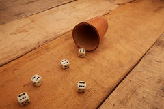 Gambling. With dice and leather cup royalty free stock images