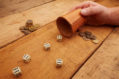 Gambling with dice for money. Gambling with dice and leather cup stock photography