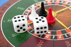 Gambling dice and roulette Stock Photos